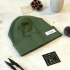 vaikiška rudeninė kepurė tamsiai žalia